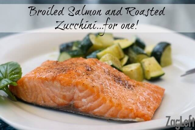 Broiled salmon fillet on a plate with chopped roasted zucchini