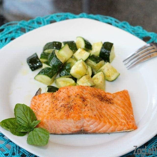 Broiled Salmon and chopped Roasted Zucchini on a plate
