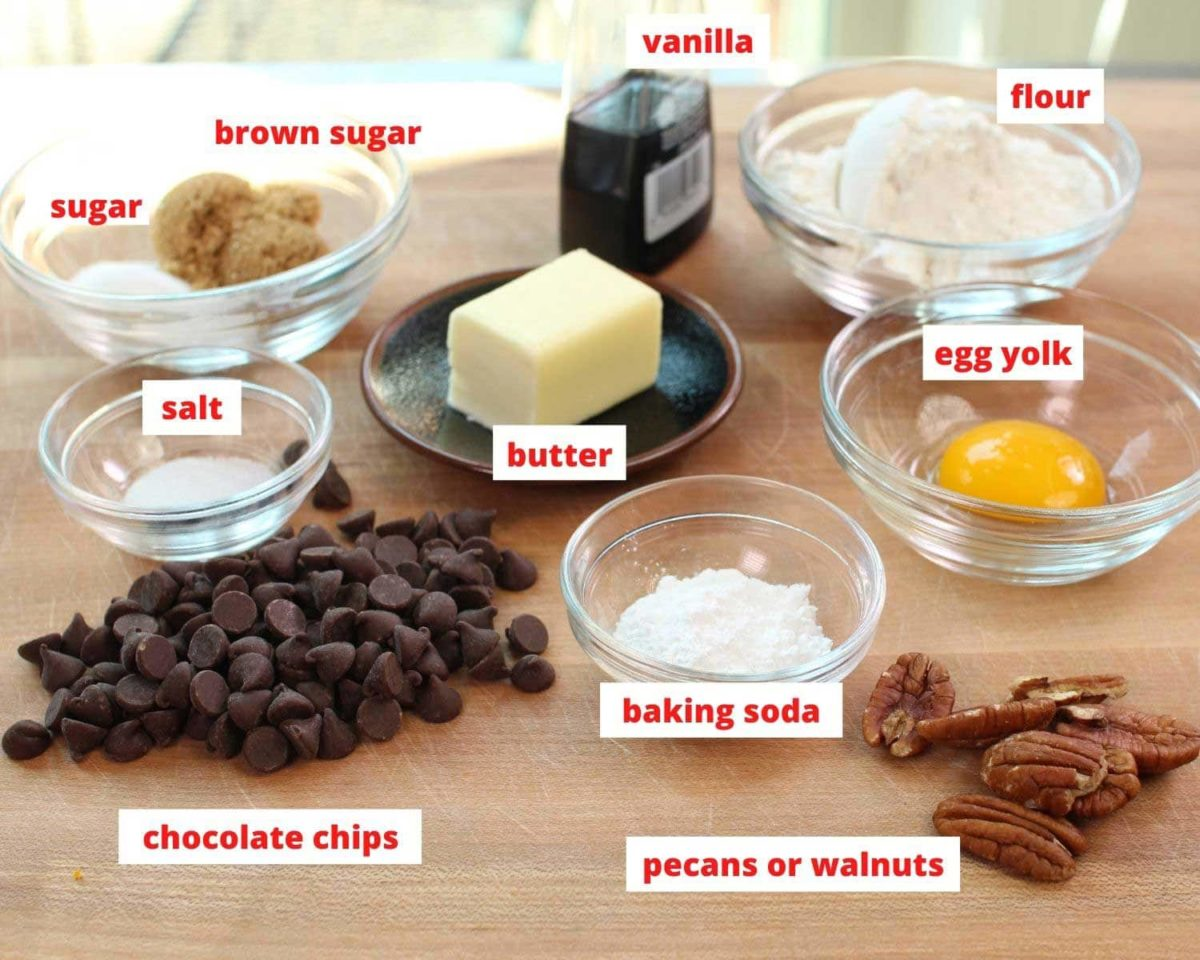 the ingredients needed to make one large chocolate chip cookie spread out on a brown table.