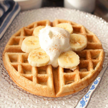 waffle with bananas and cream on top