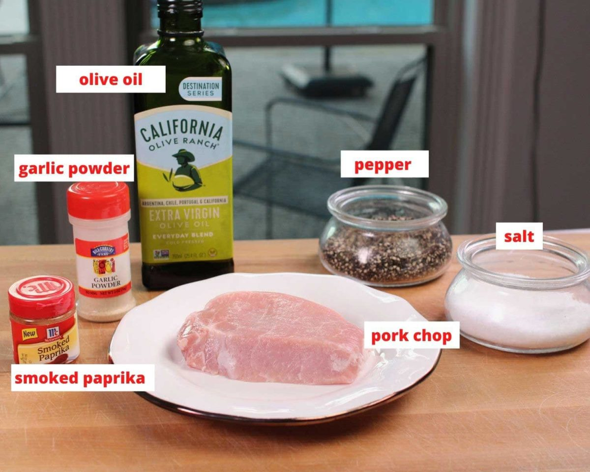 the ingredients needed to make pork chops labeled and on a brown table.