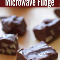 four squares of fudge on a brown cutting board.