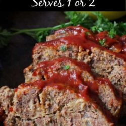 slices of meatloaf on a black tray