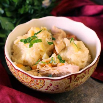 Chicken and dumplings in a bowl