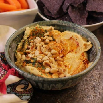 hummus in a bowl on a tray.