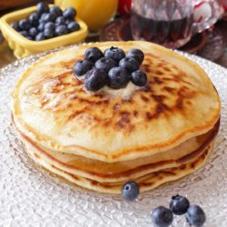 stack of pancakes for one with blueberries on top