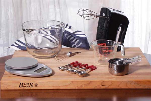 mixer, measuring cup, food weight scale and measuring spoons