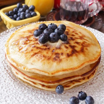 Pancakes with blueberries on plate