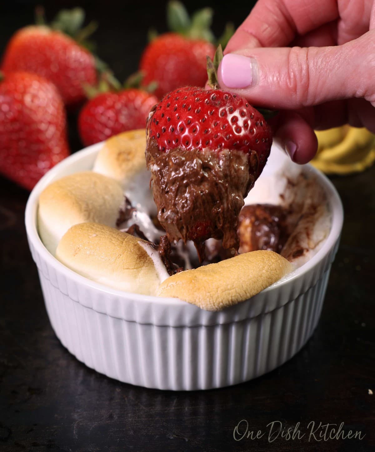 a strawberry dipped in chocolate and marshmallows