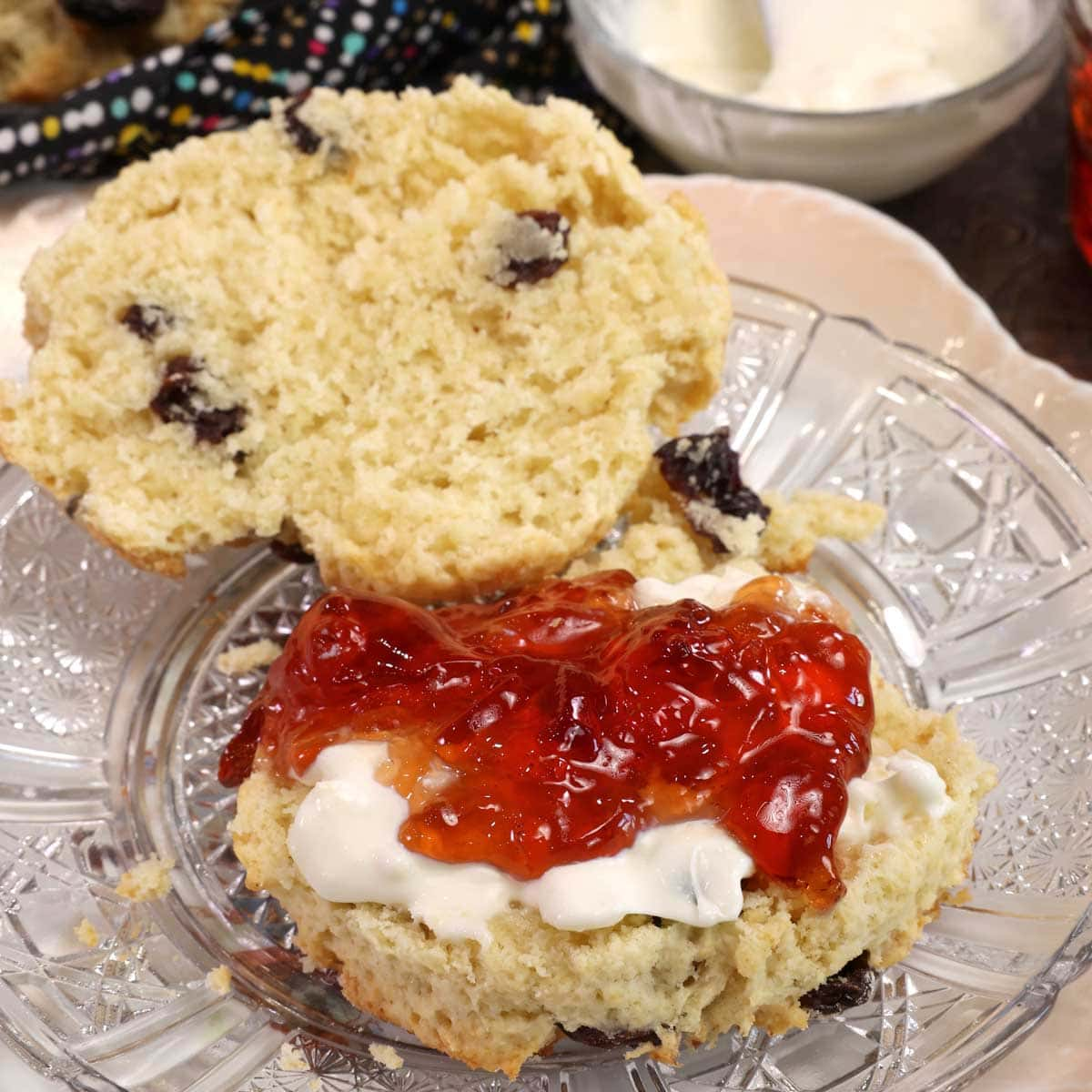 a scone topped with clotted cream and jam