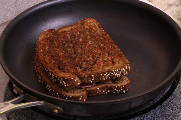 pan-grilling a reuben sandwich on a non stick skillet on the stove