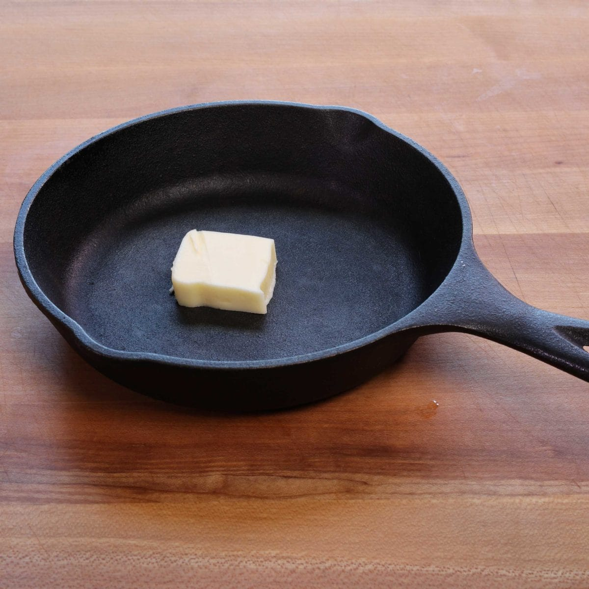a small cast iron skillet with butter in the center